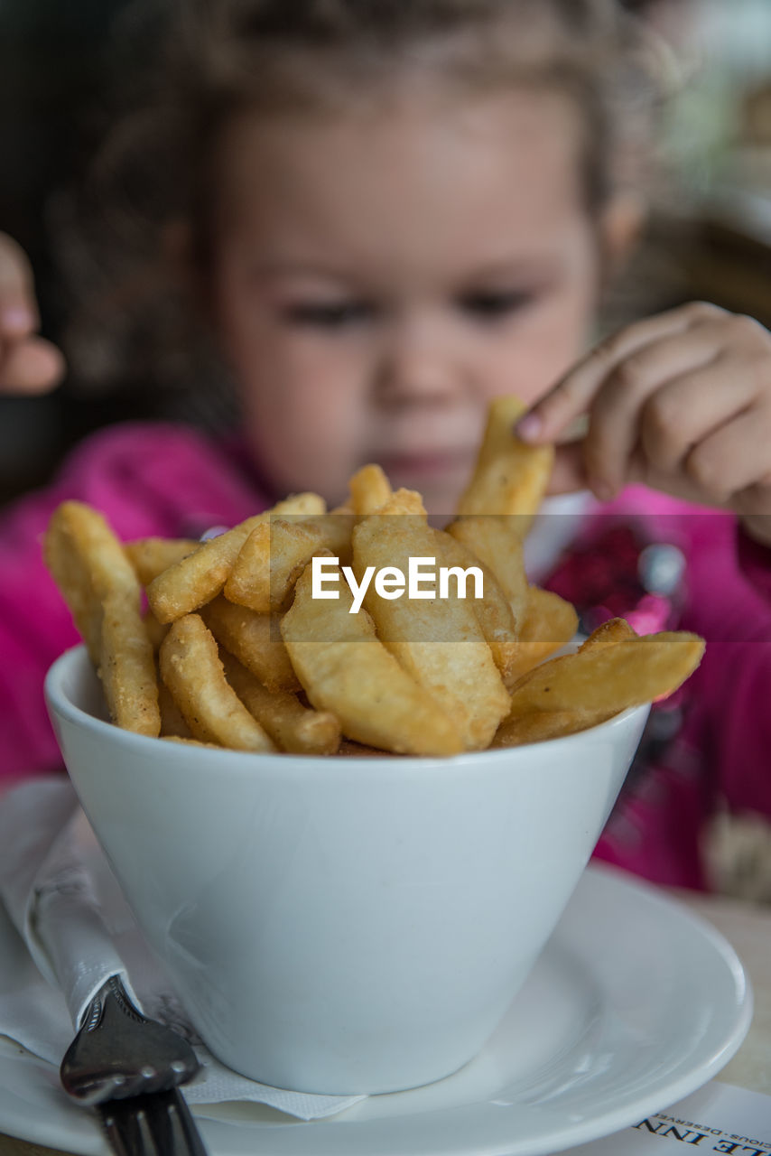 Close-Up Of French Fries In Bowl