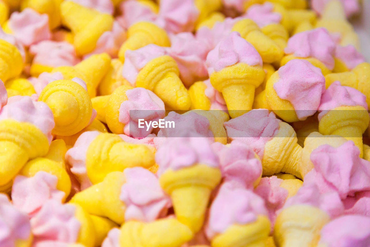 full frame, backgrounds, freshness, food and drink, food, large group of objects, yellow, abundance, still life, sweet food, indulgence, no people, close-up, unhealthy eating, indoors, selective focus, temptation, sweet, candy, wellbeing, snack