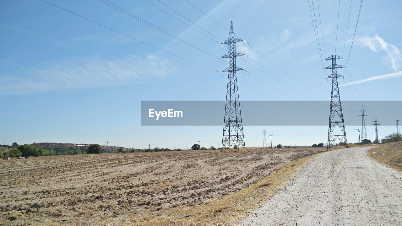 sky, electricity, technology, fuel and power generation, cable, electricity pylon, connection, nature, power line, landscape, land, field, day, no people, power supply, transportation, environment, road, cloud - sky, outdoors