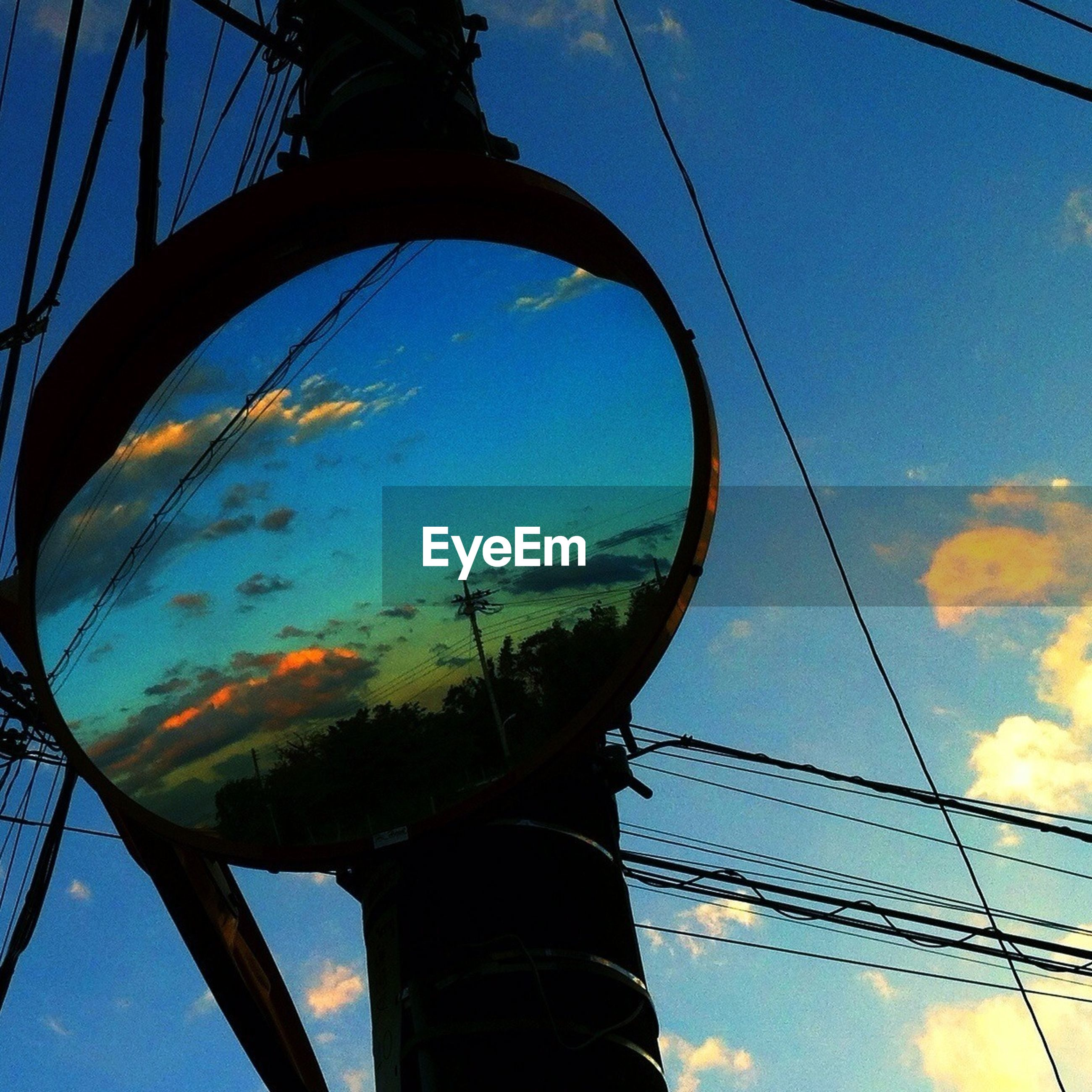 low angle view, sky, blue, part of, cloud - sky, transportation, cloud, connection, power line, metal, electricity, amusement park, outdoors, power supply, electricity pylon, ferris wheel, cable, no people, close-up, circle