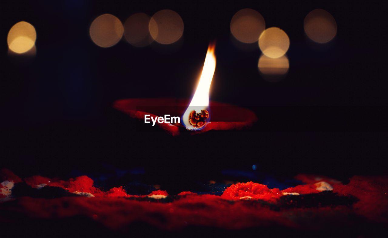 Close-Up Of Lit Diya In Dark
