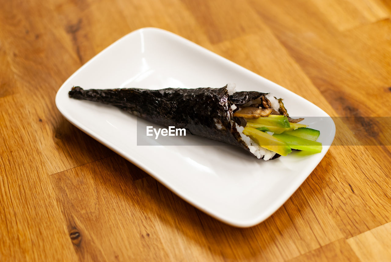 food and drink, table, food, plate, ready-to-eat, freshness, still life, indoors, close-up, wood - material, high angle view, no people, focus on foreground, serving size, indulgence, healthy eating, wellbeing, vegetable, meal, selective focus, temptation, japanese food, snack, tray
