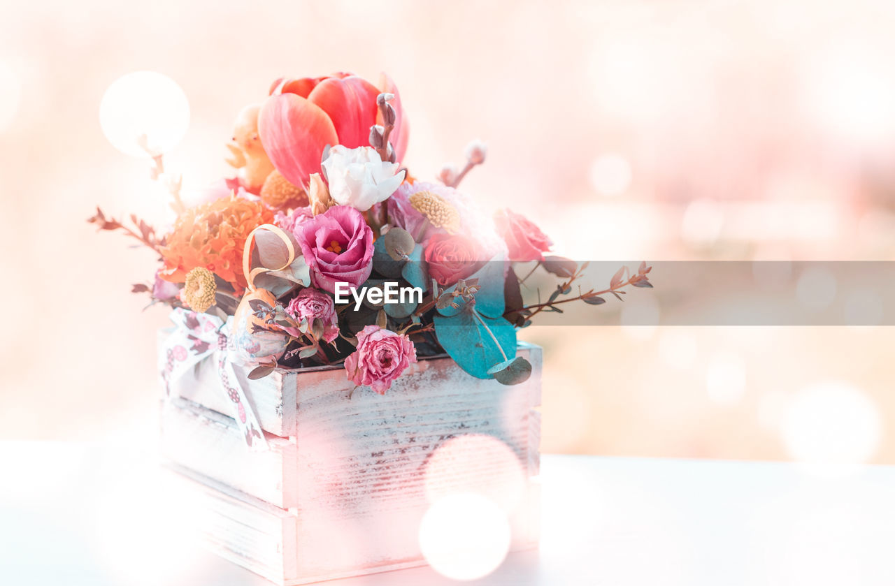 flower, flowering plant, plant, nature, close-up, beauty in nature, celebration, no people, lens flare, freshness, pink color, sunlight, flower arrangement, focus on foreground, decoration, bouquet, selective focus, event, rose, vulnerability, flower head, outdoors, softness
