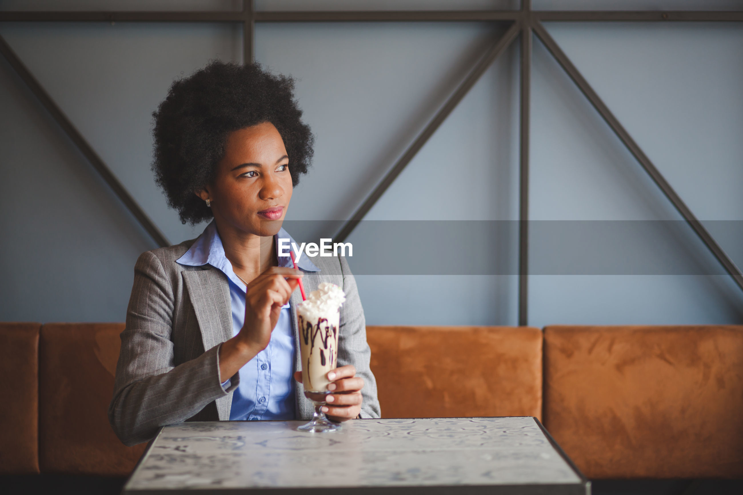 Businesswoman with cold coffee sitting in cafe