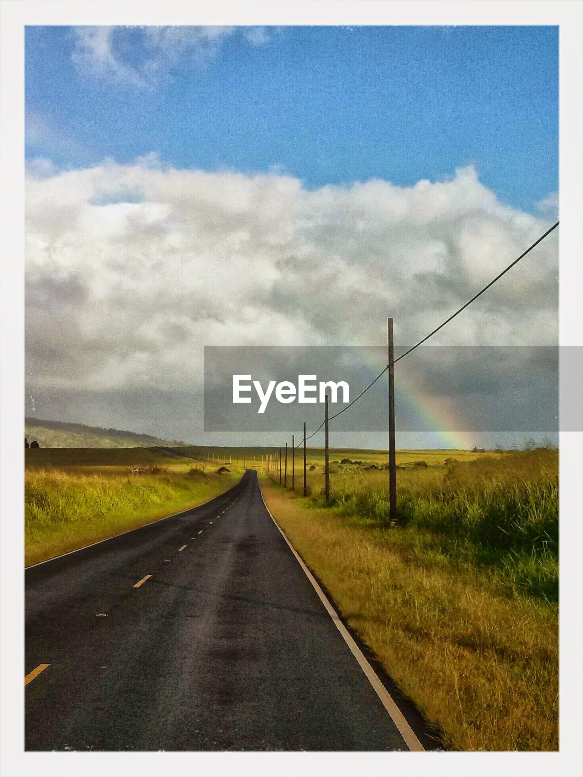 the way forward, sky, diminishing perspective, landscape, vanishing point, road, field, transportation, cloud - sky, cloud, tranquil scene, country road, tranquility, transfer print, cloudy, rural scene, grass, nature, horizon over land, electricity pylon