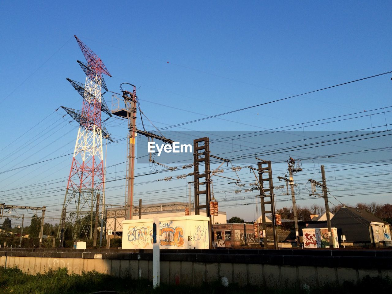 cable, electricity pylon, no people, day, outdoors, clear sky, sky, architecture, built structure, building exterior