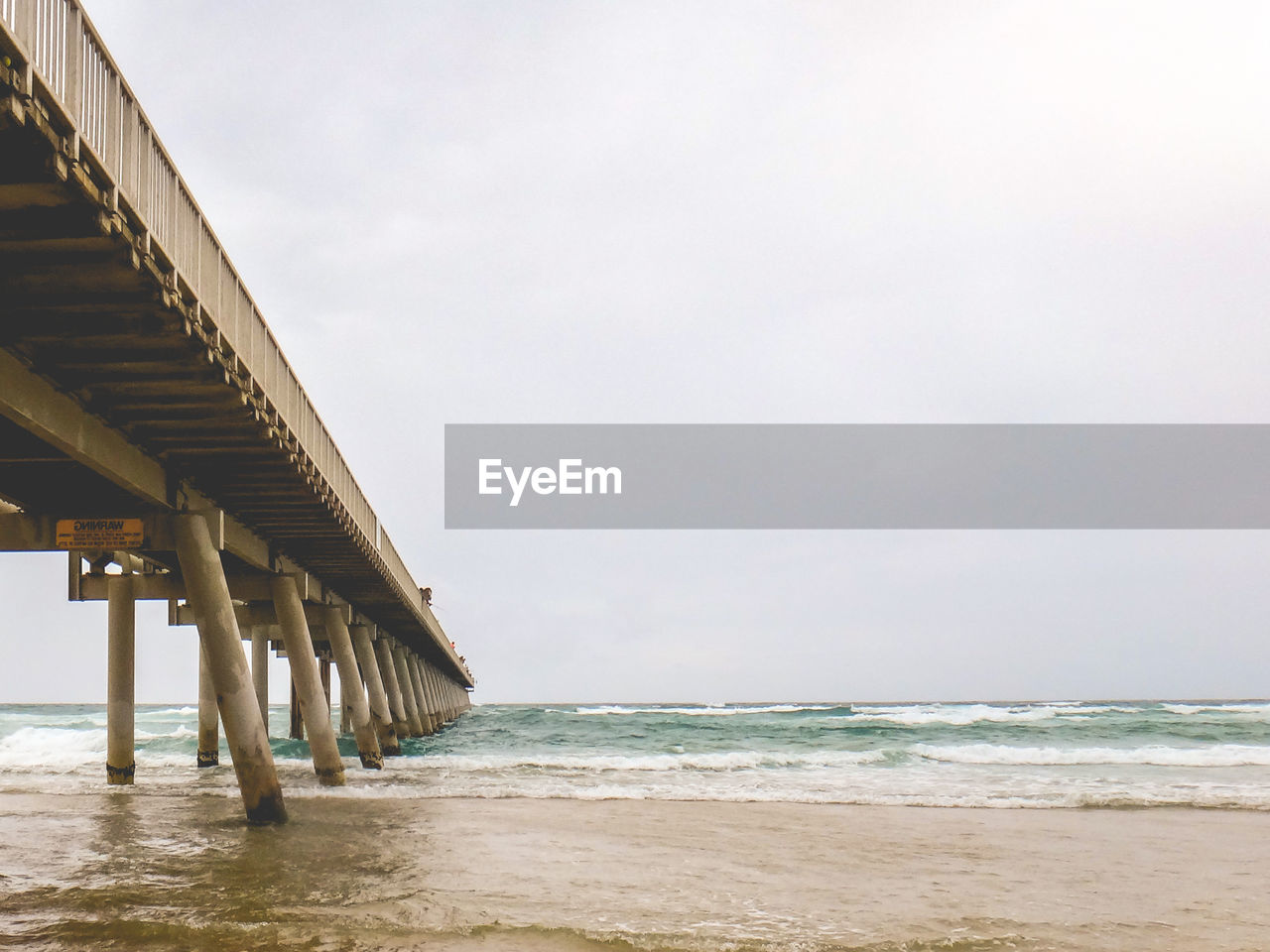 sea, water, beach, sky, land, horizon over water, horizon, built structure, architecture, scenics - nature, beauty in nature, nature, motion, sand, no people, architectural column, tranquility, day, tranquil scene, outdoors, long, underneath