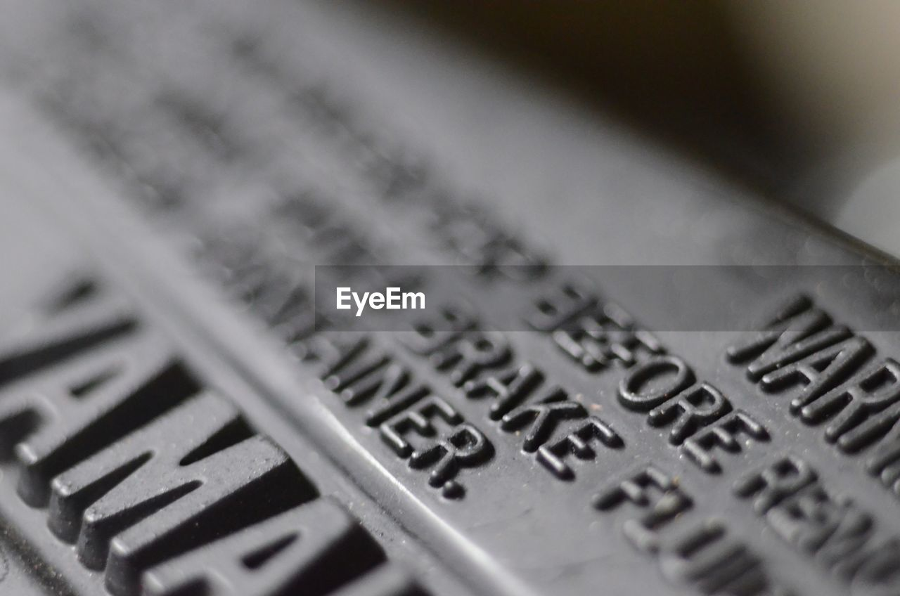 text, selective focus, close-up, indoors, no people, communication, day