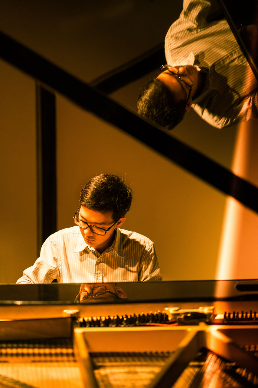 Portrait Of Young Man Playing Piano