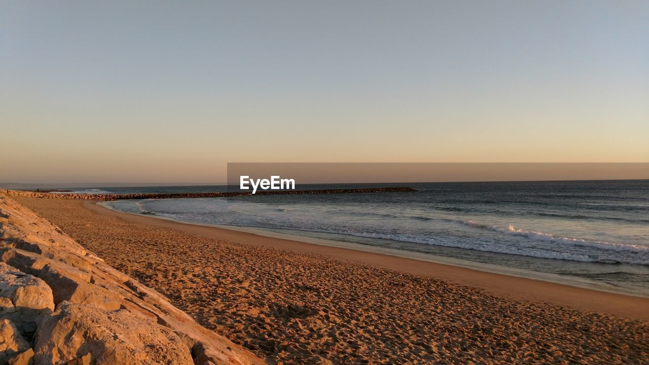sea, beach, clear sky, nature, scenics, beauty in nature, sand, tranquility, tranquil scene, water, horizon over water, no people, outdoors, sky, sunset, day