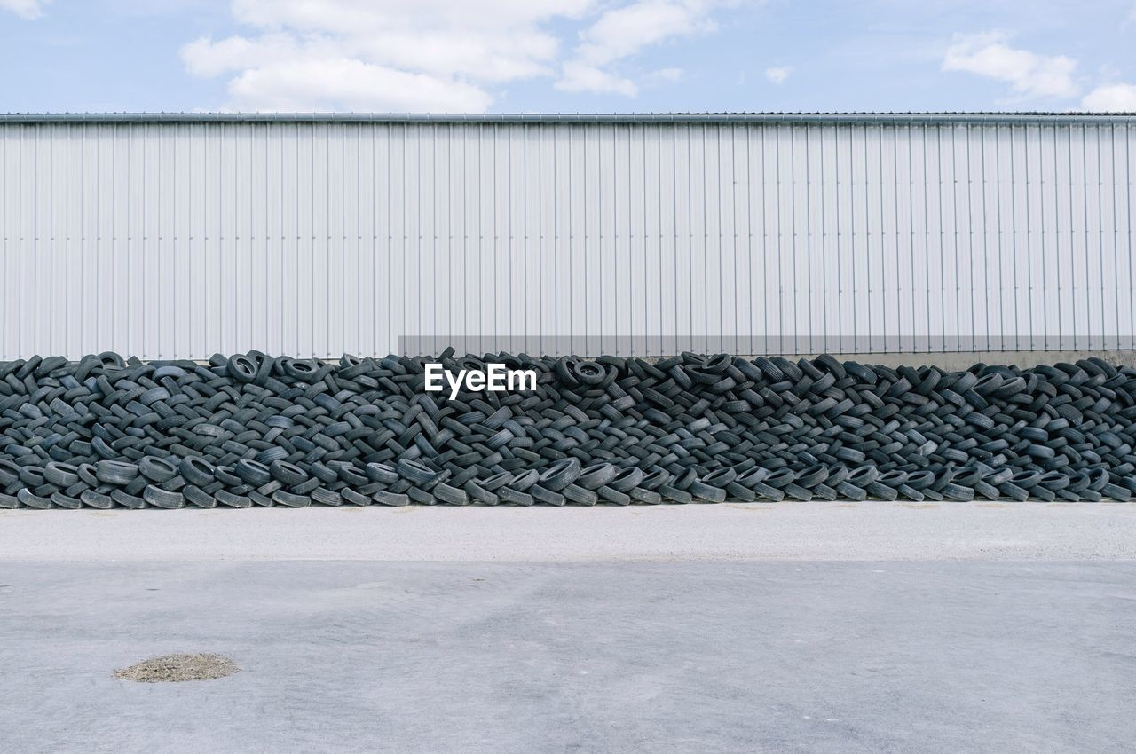 Stack Of Tyres Piled Up Against Wall