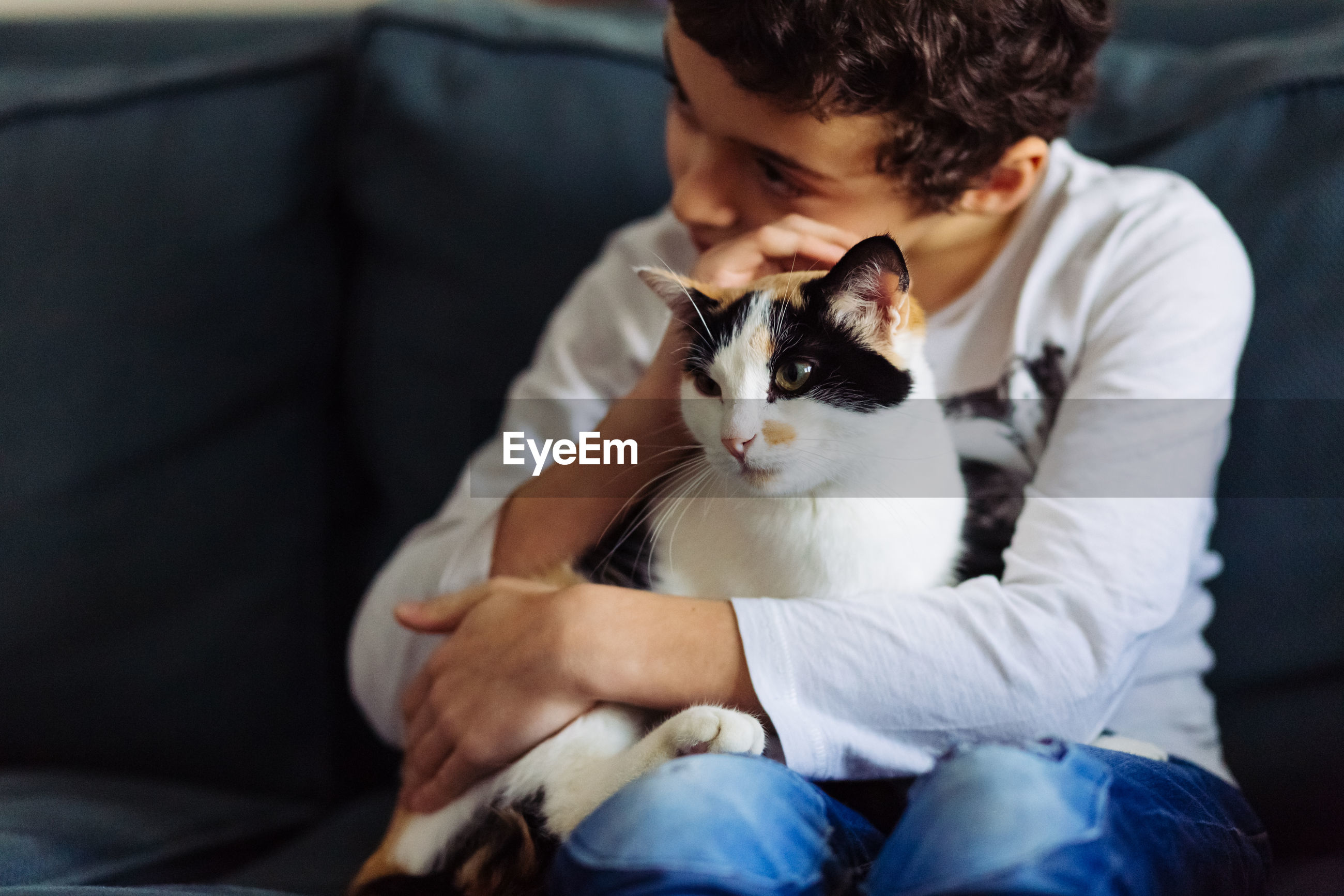 Young man sitting with cat