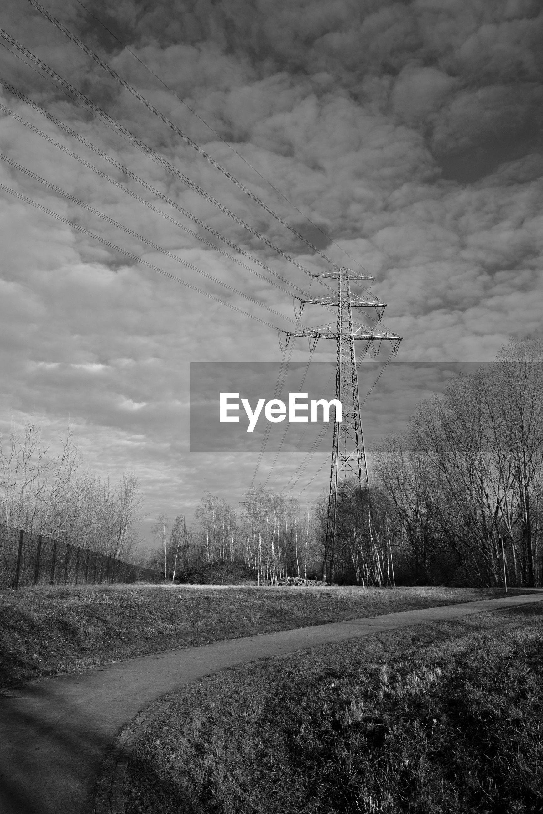ELECTRICITY PYLONS ON LAND AGAINST SKY