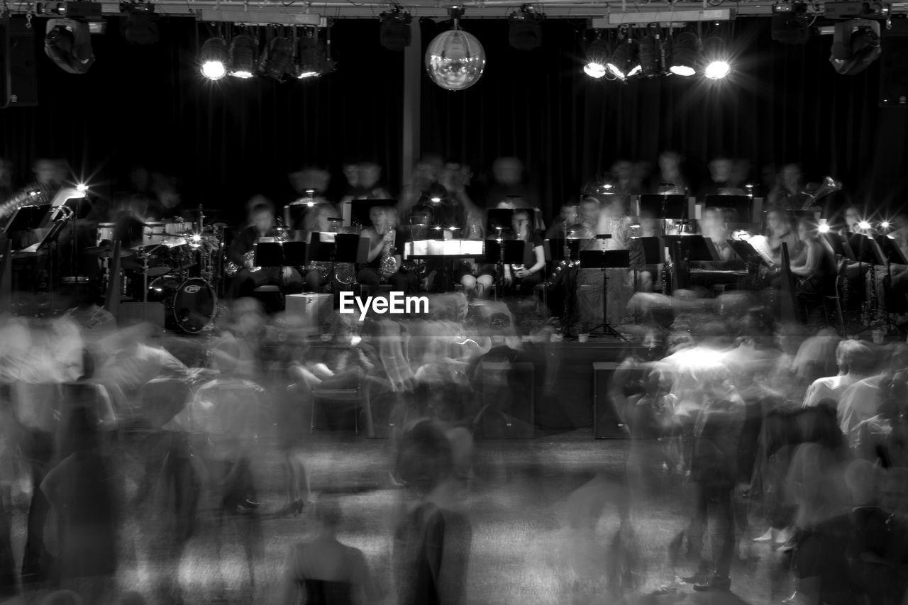 large group of people, night, illuminated, real people, men, crowd, indoors, women, nightlife, people