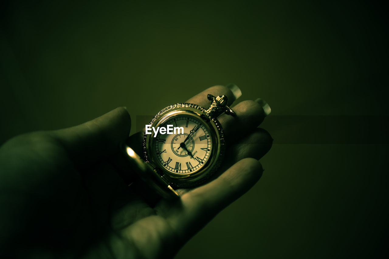 human hand, hand, human body part, holding, watch, one person, studio shot, time, indoors, body part, close-up, real people, human finger, unrecognizable person, finger, pocket watch, wristwatch, number, personal perspective, clock, luxury, personal accessory, human limb