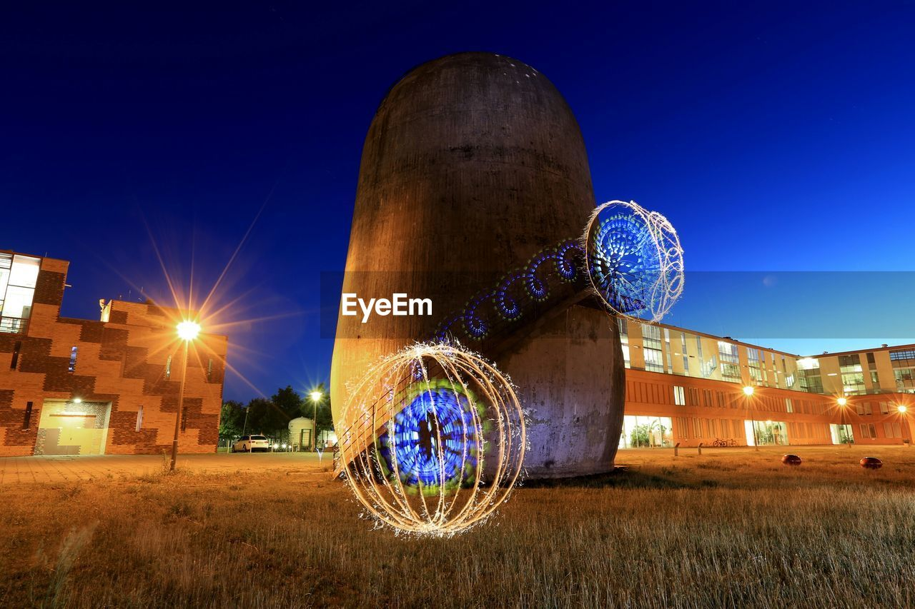 Light painting against trudelturm at night