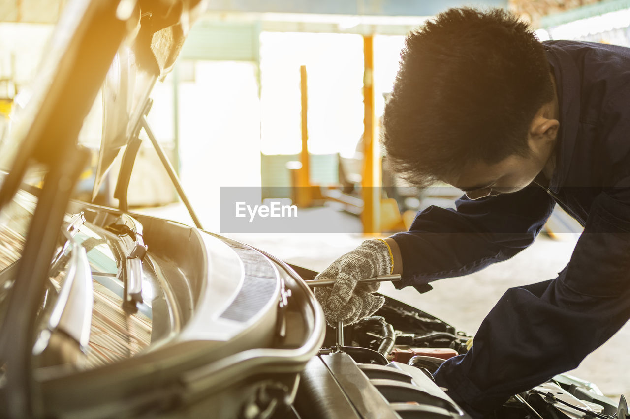 Mechanic repairing car at auto repair shop