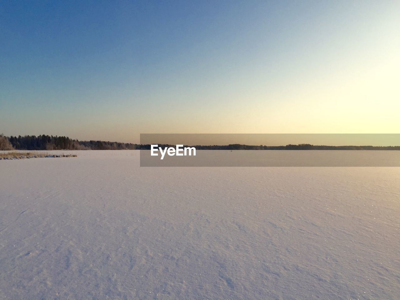winter, cold temperature, scenics - nature, tranquil scene, snow, tranquility, beauty in nature, sky, copy space, environment, clear sky, landscape, non-urban scene, nature, no people, sunset, land, idyllic, remote, outdoors, salt flat