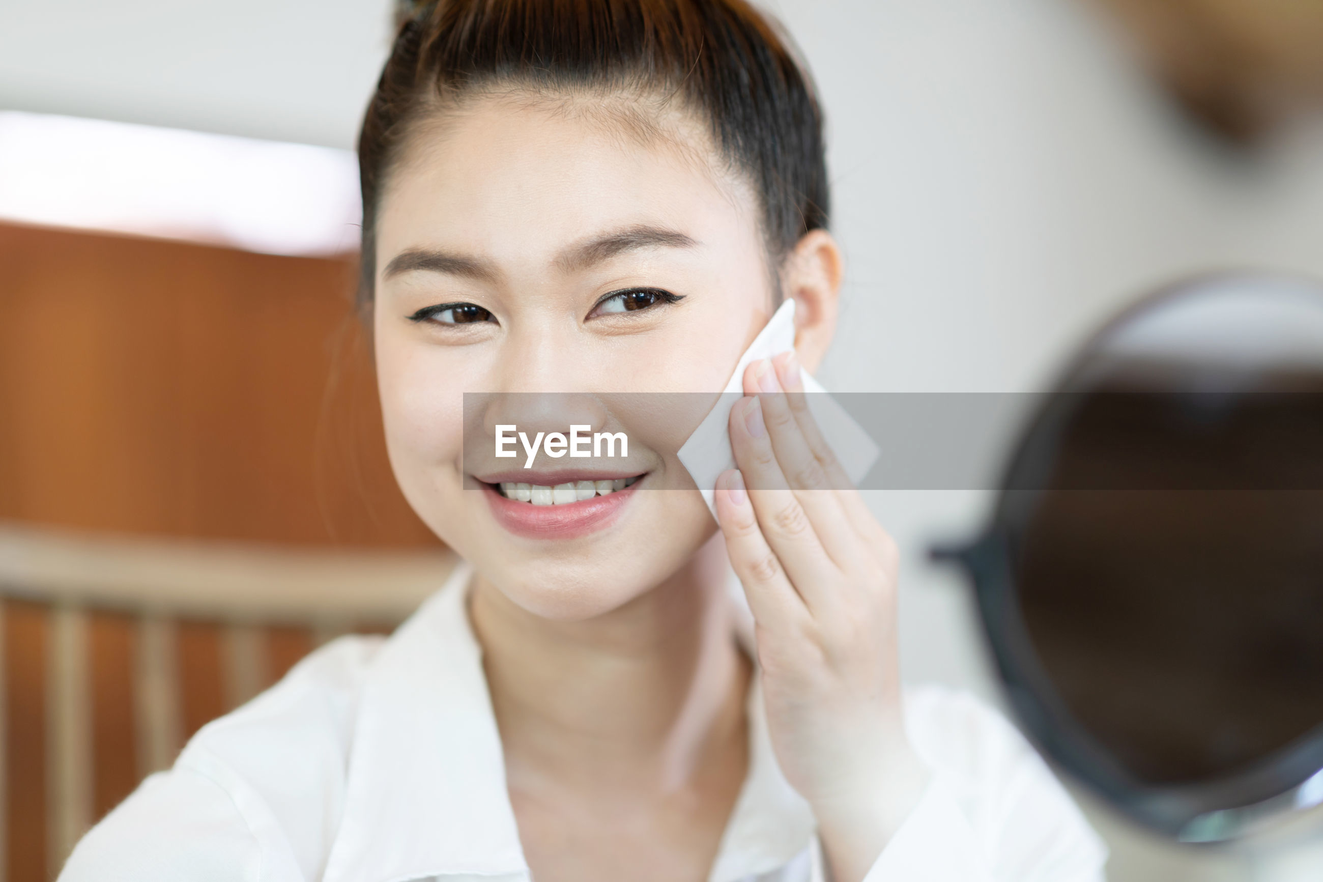 Smiling woman wiping face