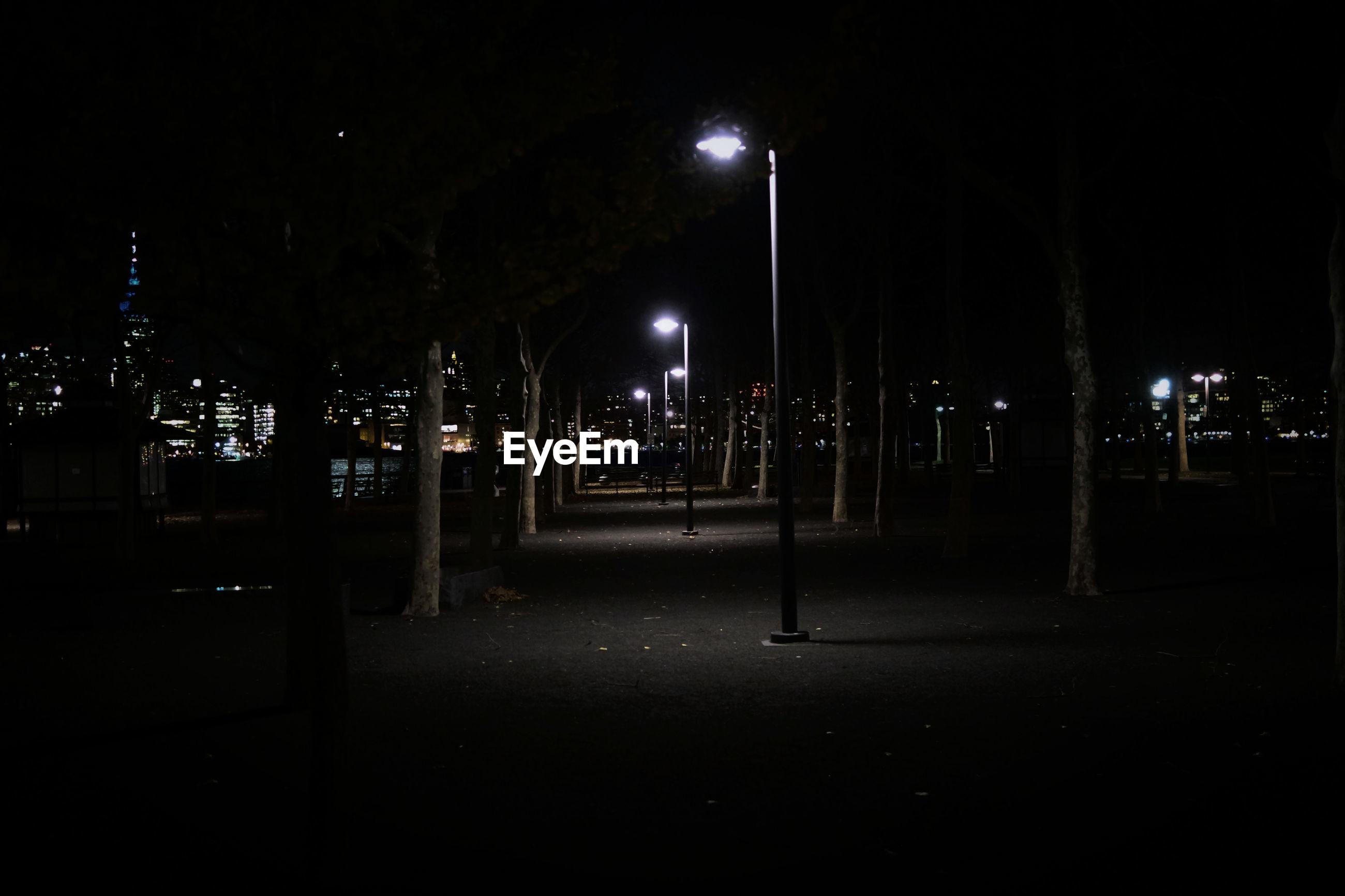VIEW OF ILLUMINATED STREET LIGHT IN NIGHT