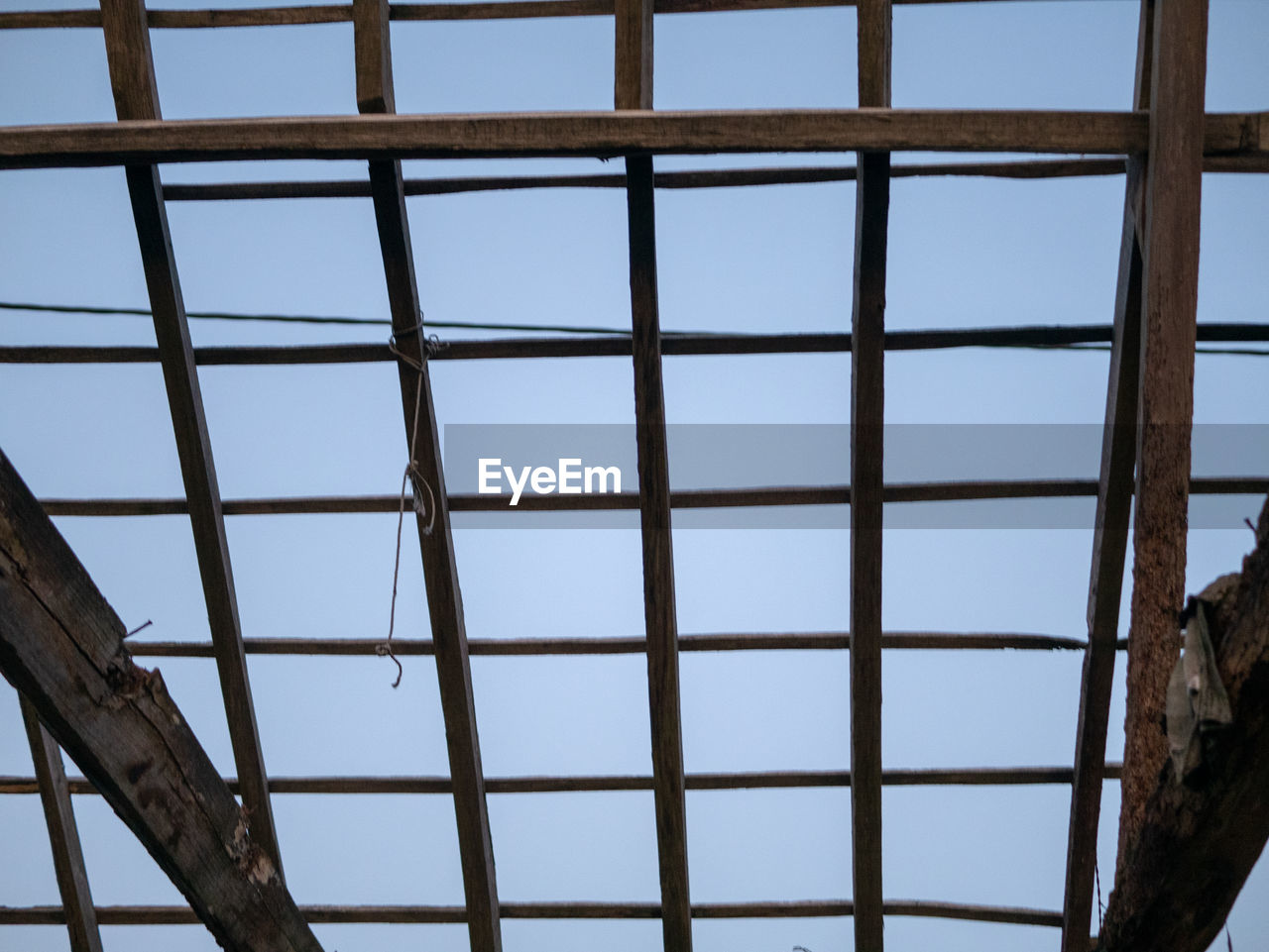 sky, built structure, architecture, no people, day, low angle view, metal, pattern, window, clear sky, nature, outdoors, glass - material, blue, close-up, building, roof, transparent, roof beam, girder