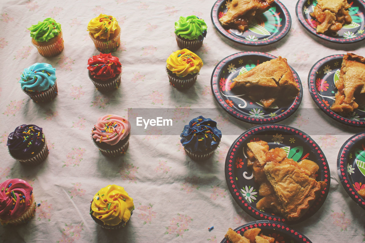 High Angle View Of Apple Pies And Cupcakes On Table