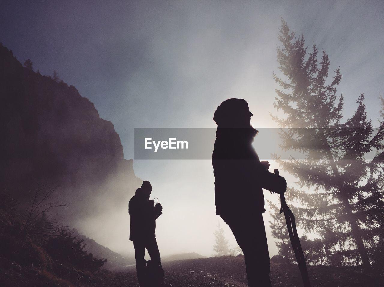 Silhouette of couple on mountain