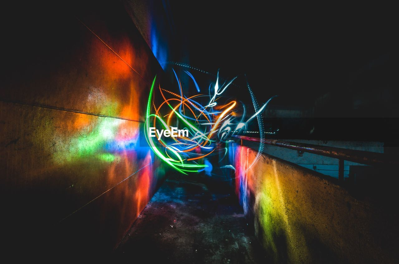 illuminated, multi colored, night, long exposure, light painting, motion, glowing, wall - building feature, no people, creativity, light - natural phenomenon, indoors, architecture, blurred motion, light trail, art and craft, built structure, dark, graffiti