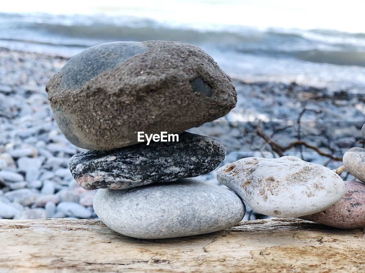 solid, rock, rock - object, stone - object, pebble, stone, focus on foreground, stack, close-up, land, nature, balance, day, no people, textured, zen-like, outdoors, beach, tranquility, sea