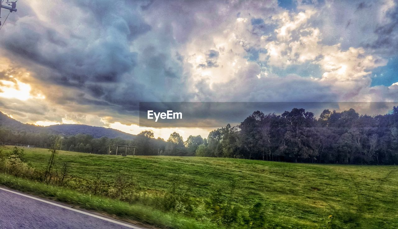 cloud - sky, sky, scenics - nature, tranquil scene, beauty in nature, landscape, plant, environment, grass, tranquility, no people, nature, field, land, tree, green color, rural scene, mountain, non-urban scene, outdoors