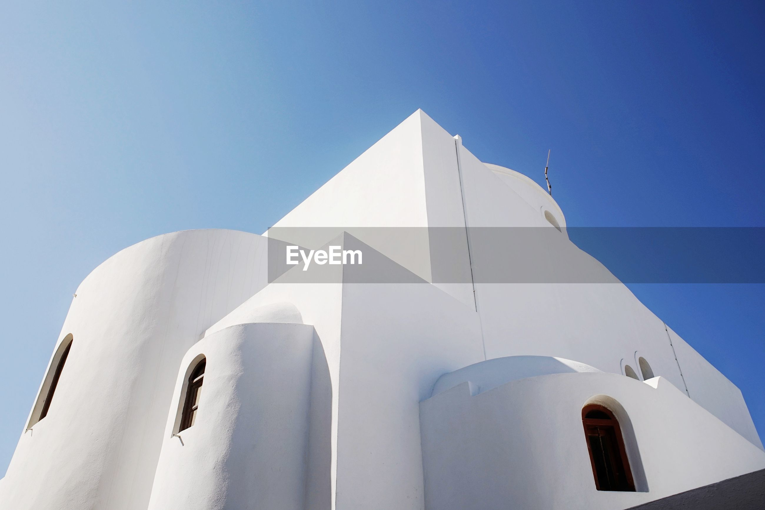 Low angle view of white cathedral against clear blue sky