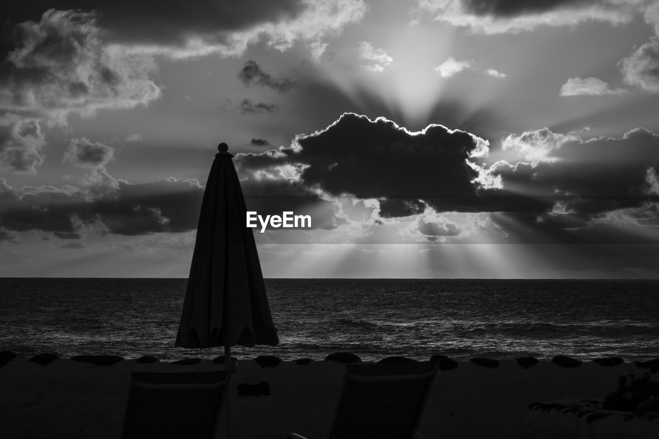 sea, cloud - sky, sky, water, horizon, horizon over water, scenics - nature, beauty in nature, beach, nature, land, tranquil scene, tranquility, no people, idyllic, sunlight, non-urban scene, sunbeam, outdoors, sailboat