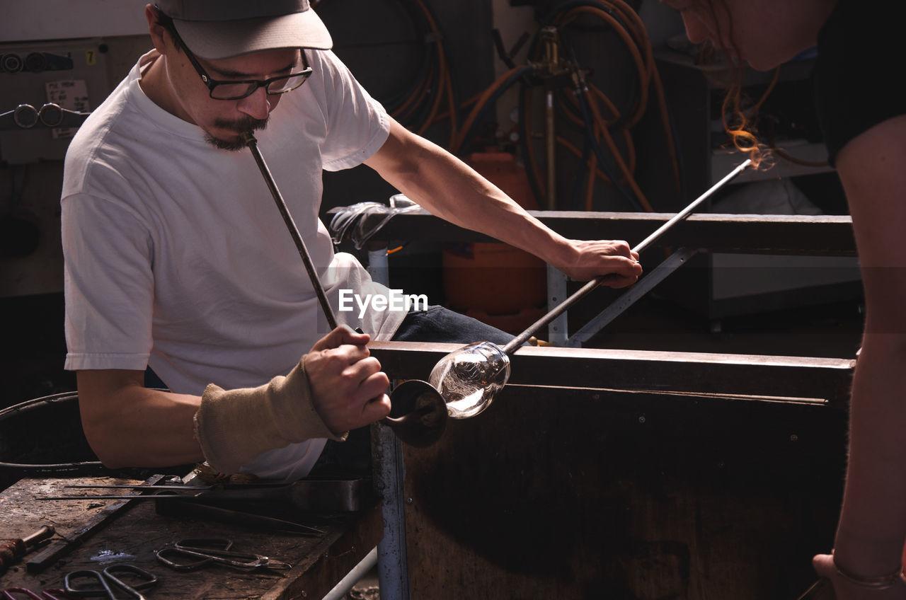 Man Manufacturing Glass