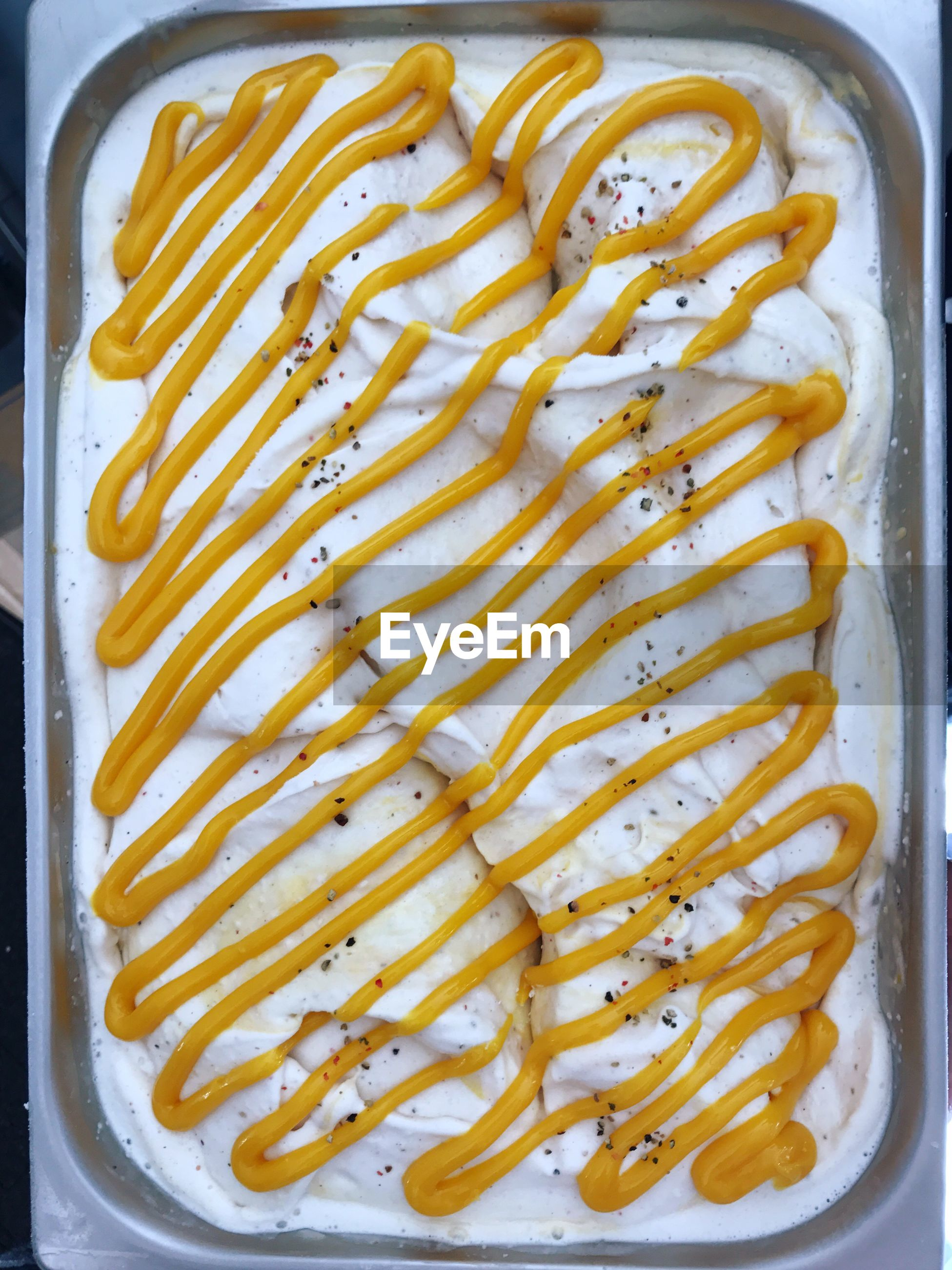 Directly above shot of lemon ice cream in container