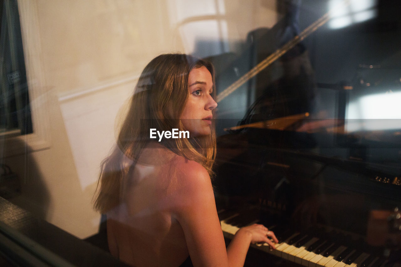 musical instrument, musical equipment, piano, music, playing, arts culture and entertainment, one person, musician, young adult, artist, skill, waist up, home interior, sitting, indoors, young women, hair, lifestyles, looking, hairstyle, beautiful woman, piano key, keyboard