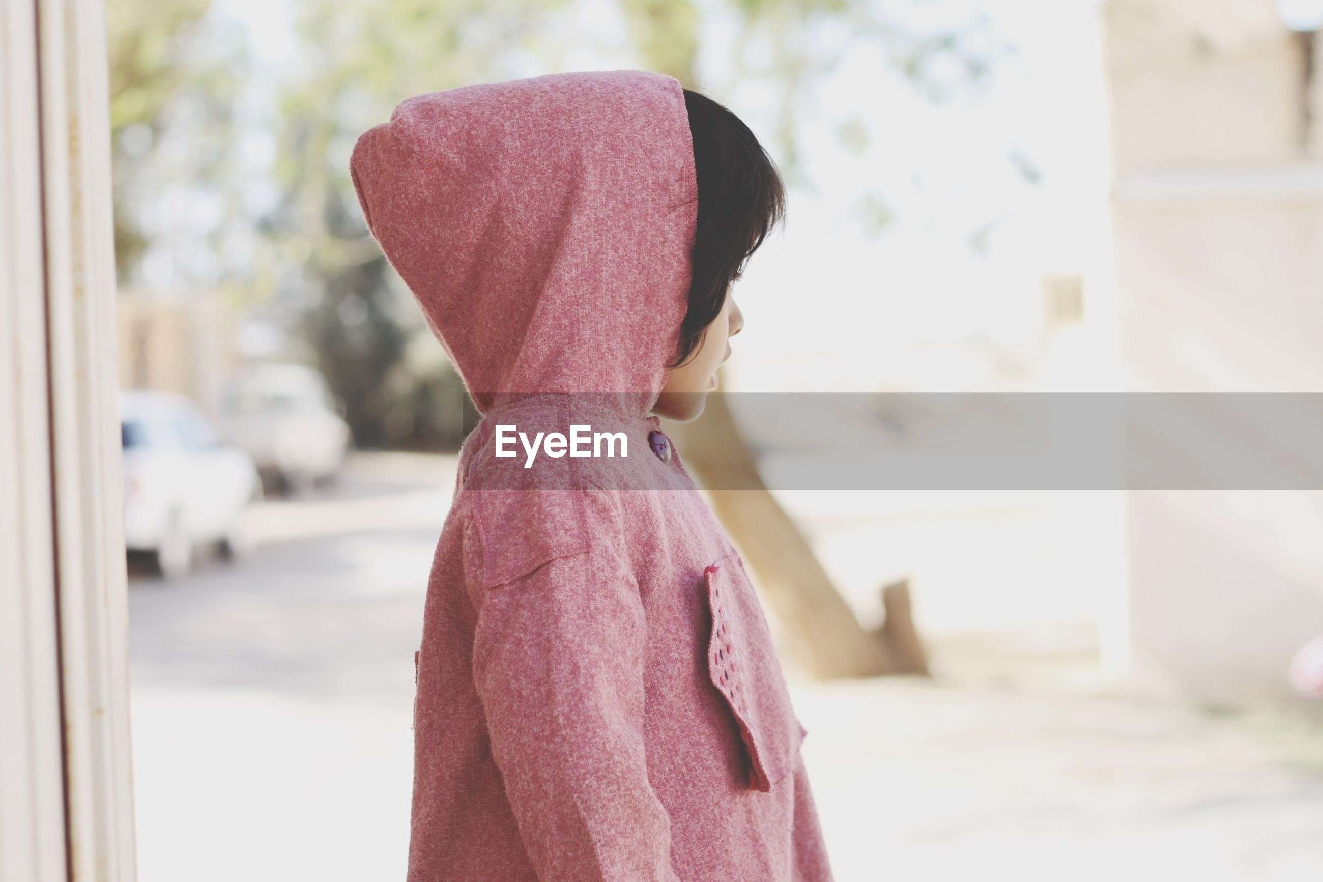 focus on foreground, close-up, selective focus, indoors, day, textile, fabric, hanging, incidental people, person, red, fashion, art and craft, sunlight, pink color, rear view, clothing