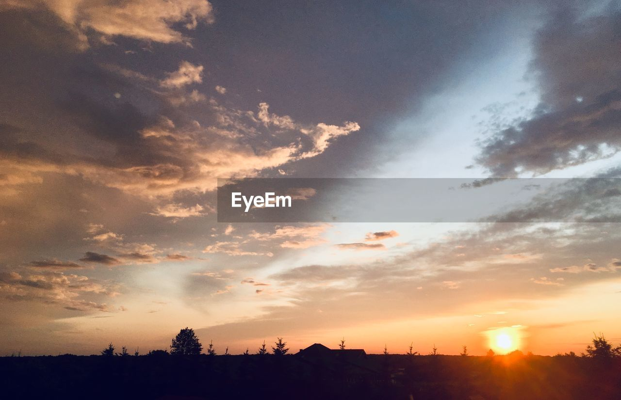 sky, sunset, cloud - sky, beauty in nature, silhouette, scenics - nature, tranquil scene, tranquility, nature, orange color, sun, sunlight, no people, landscape, idyllic, environment, sunbeam, architecture, outdoors, building exterior