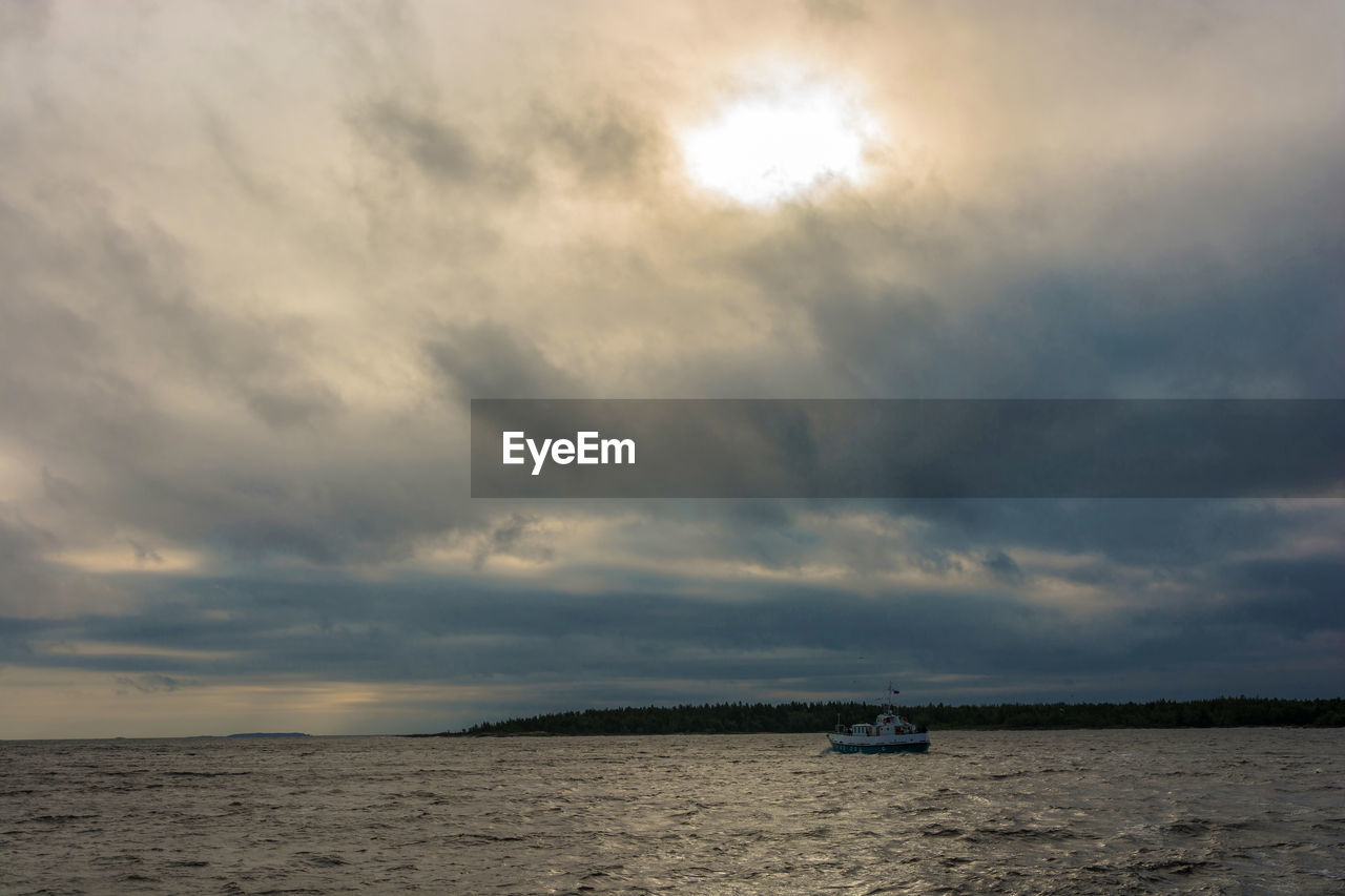 cloud - sky, sky, transportation, mode of transportation, nature, scenics - nature, beauty in nature, nautical vessel, tranquility, no people, sea, water, tranquil scene, land, overcast, sunset, horizon, outdoors, day