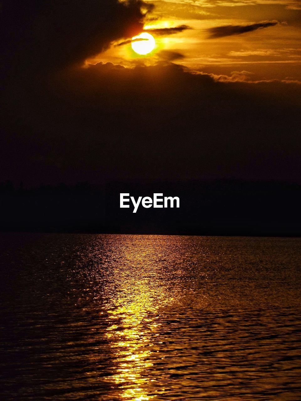 Idyllic Shot Of Orange Sunset Sky Over Lake
