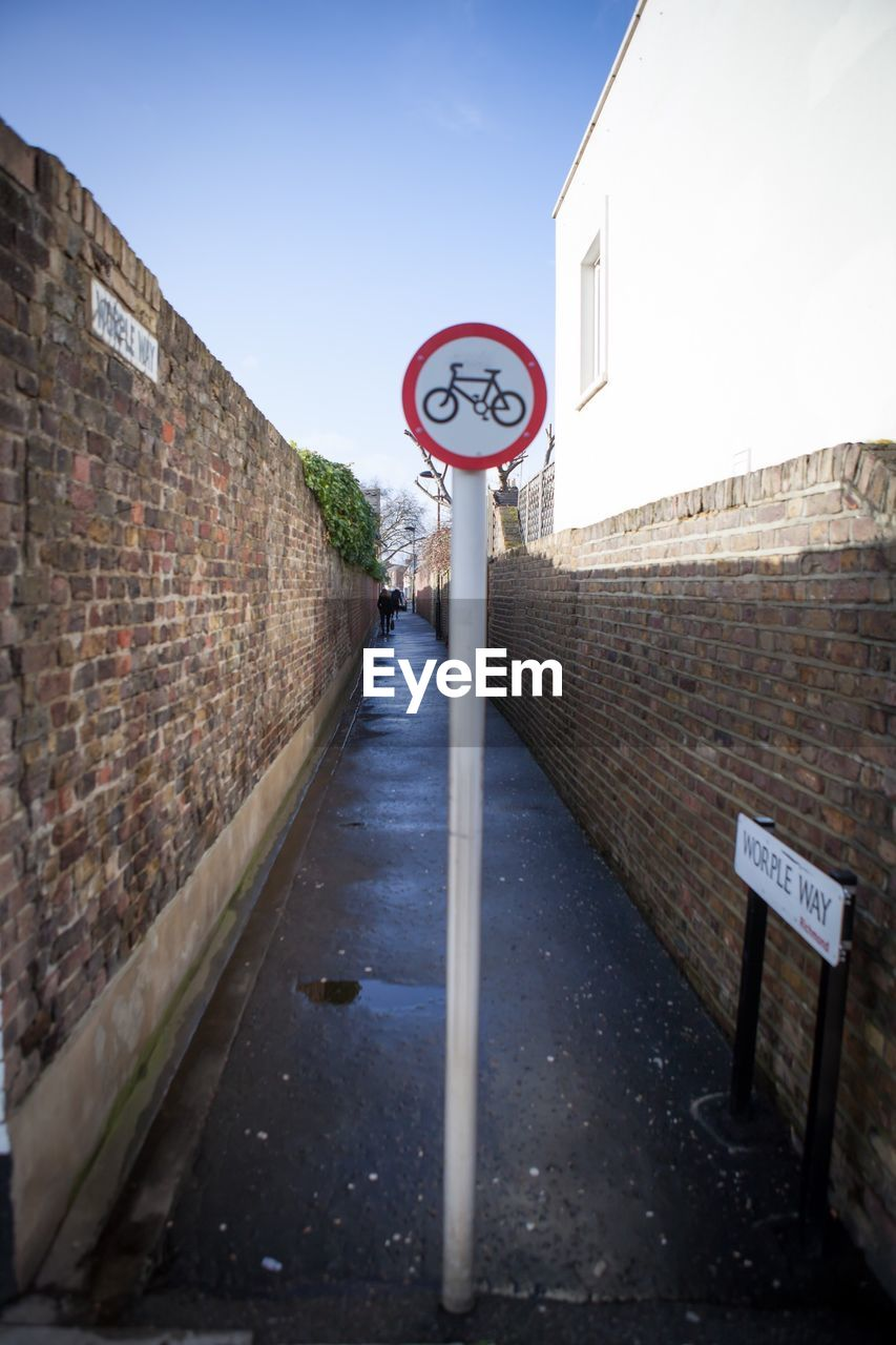 Bicycle Lane Amidst Wall