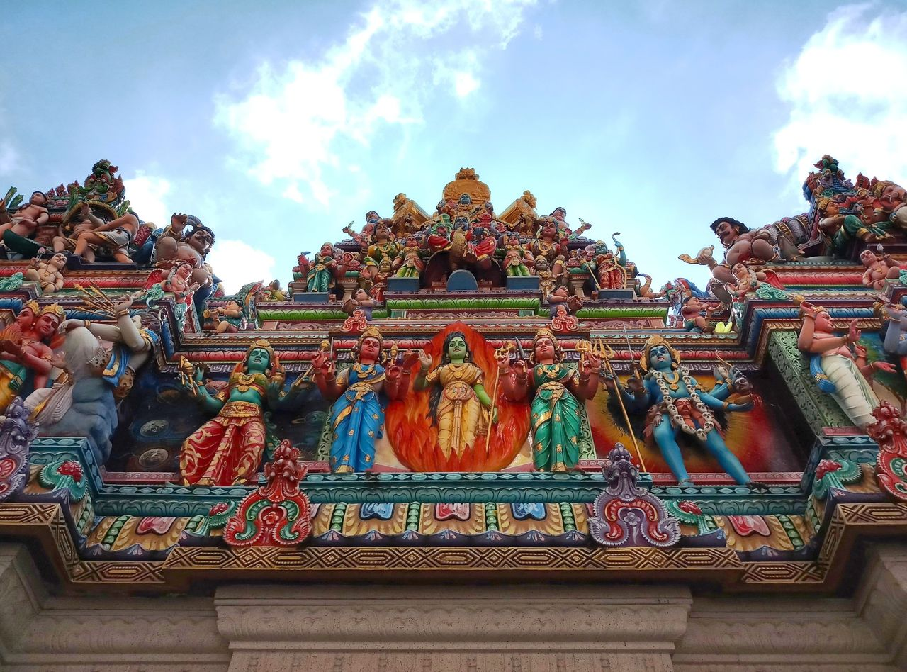 art and craft, religion, belief, representation, sculpture, spirituality, architecture, built structure, creativity, statue, place of worship, human representation, craft, sky, cloud - sky, low angle view, building, no people, ornate, carving, shrine