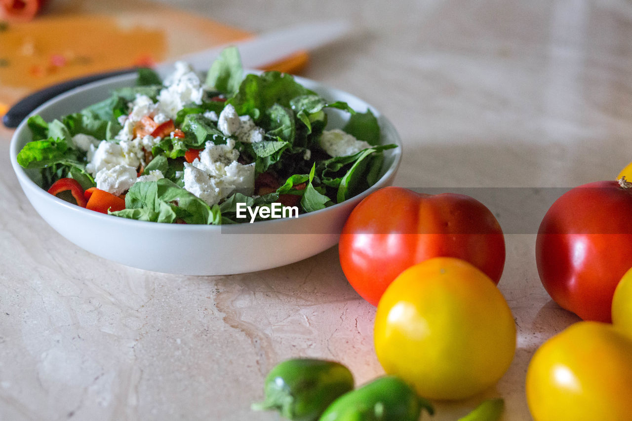 Close-Up Of Salad In Bowl On Kitchen Counter