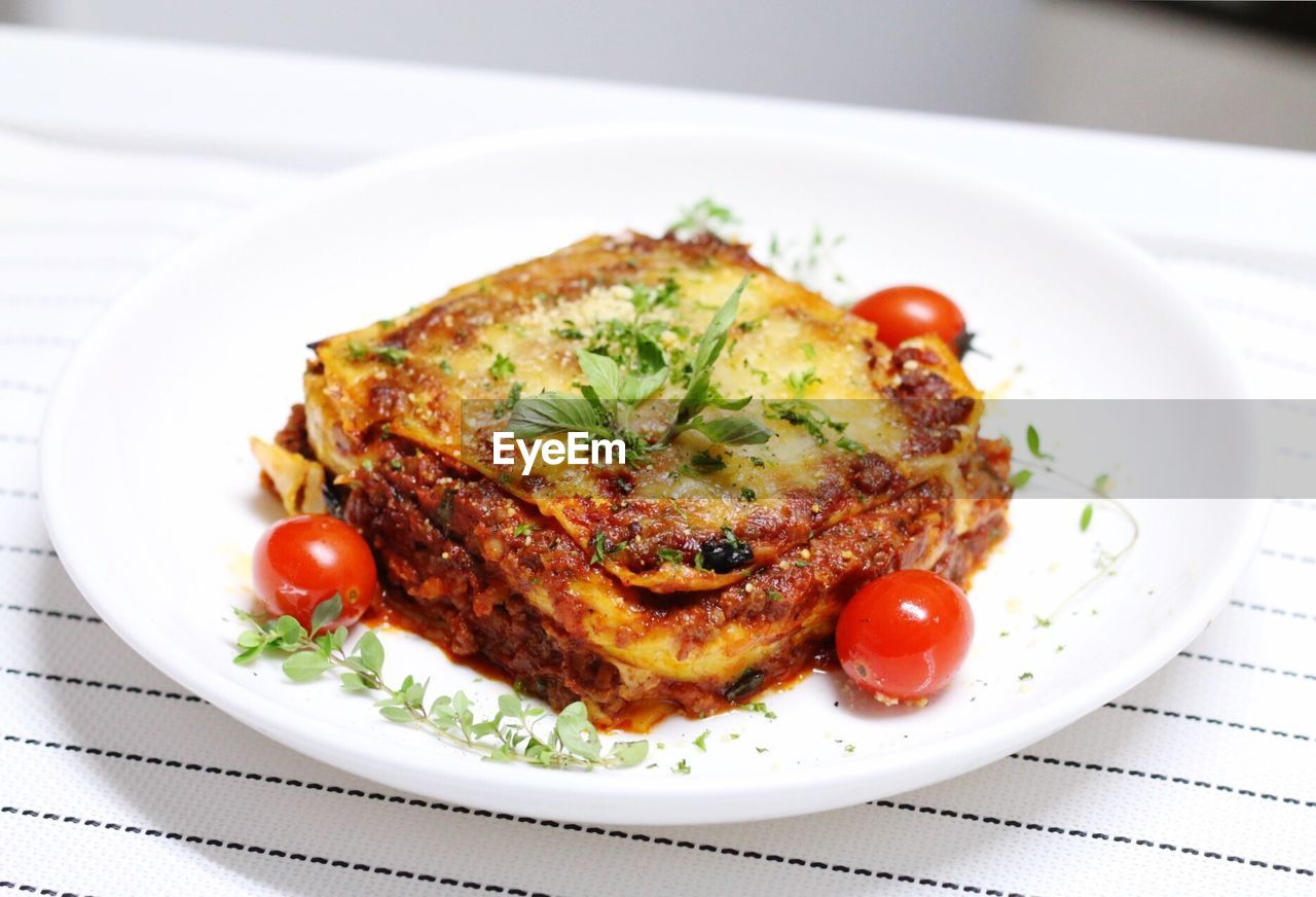 High Angle View Of Lasagna Served On Table