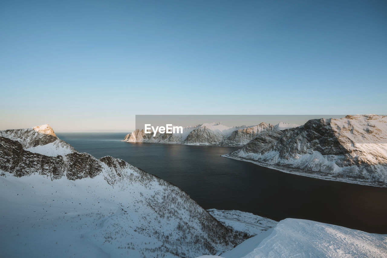 water, sky, scenics - nature, beauty in nature, cold temperature, winter, tranquility, tranquil scene, copy space, snow, nature, clear sky, non-urban scene, no people, idyllic, day, blue, mountain, snowcapped mountain