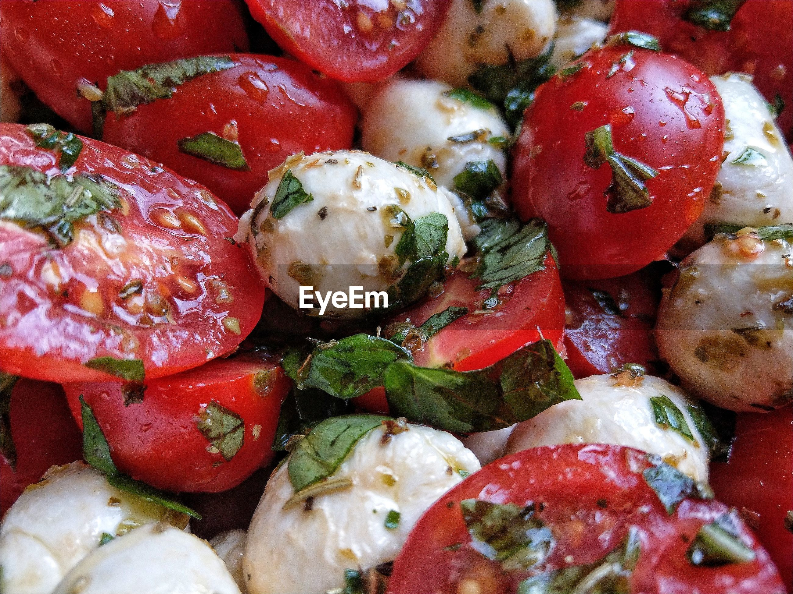 Full frame shot of cherry tomatoes with mozzarella
