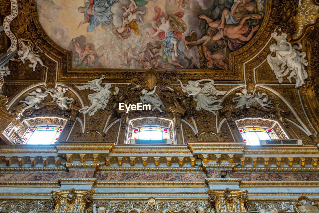 architecture, built structure, place of worship, indoors, ceiling, belief, low angle view, religion, spirituality, mural, art and craft, building, representation, no people, human representation, travel destinations, tourism, fresco, cupola, ornate, altar, architecture and art