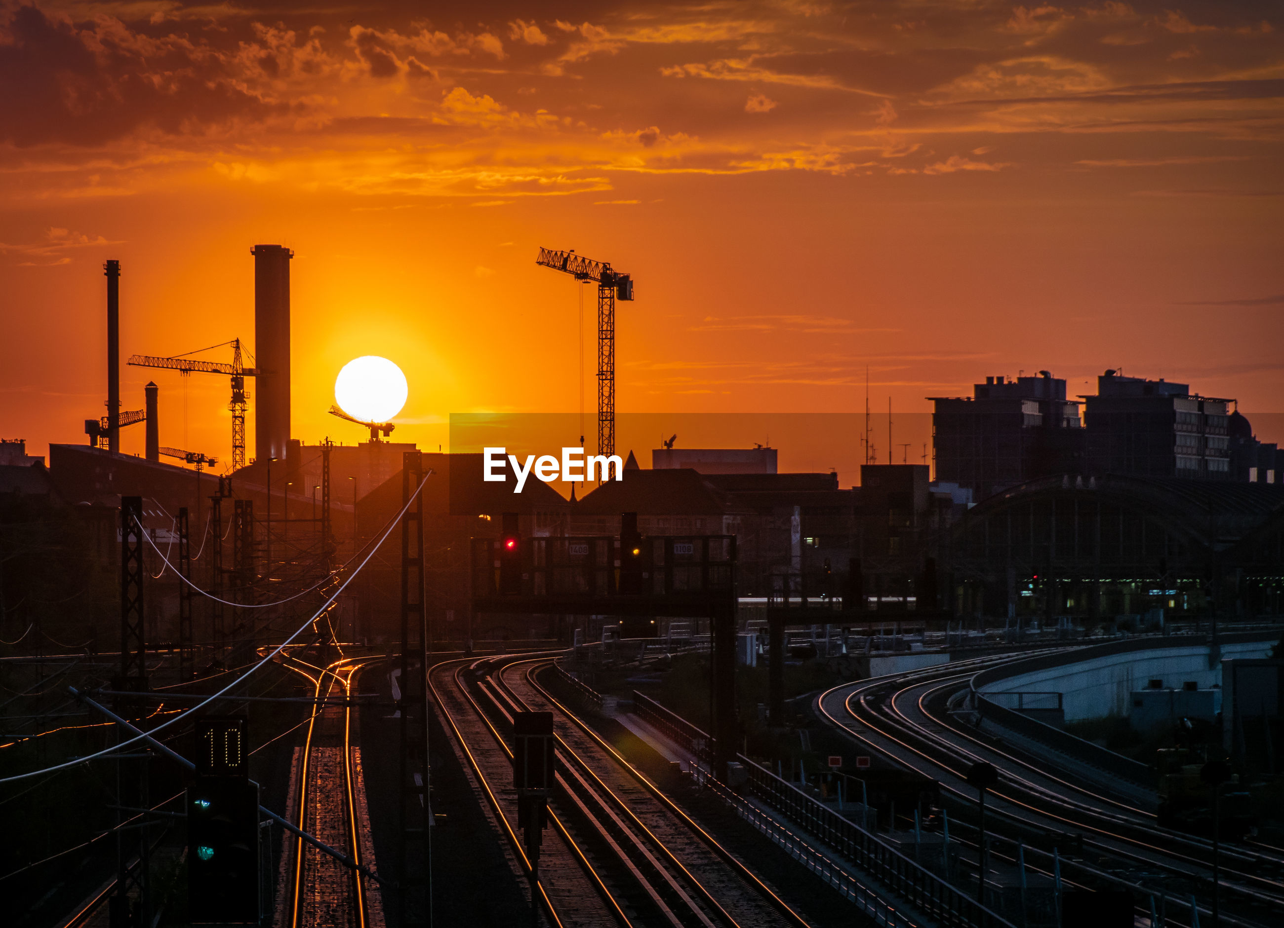 High angle view of railroad tracks against sky during sunset