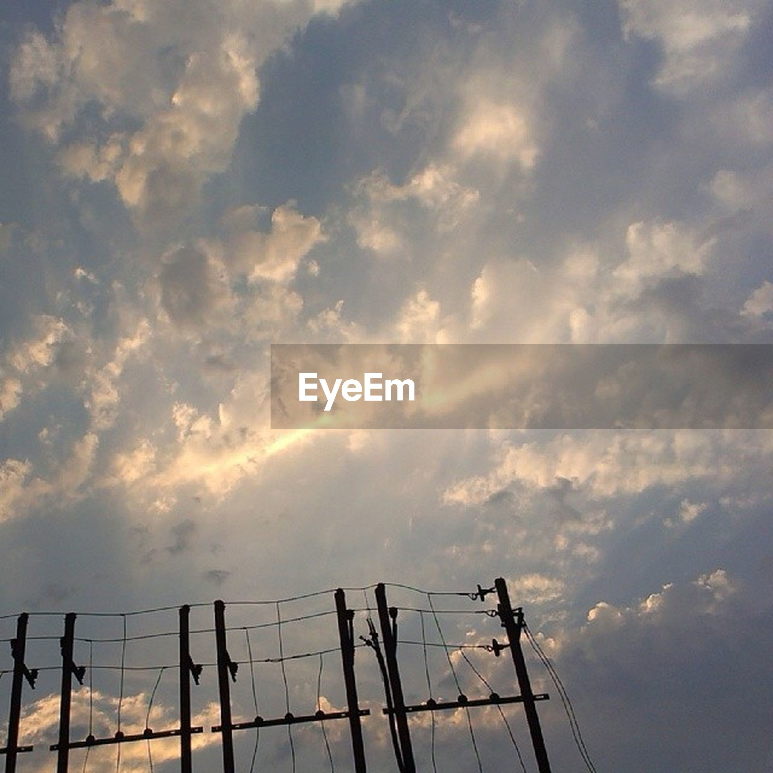 sky, cloud - sky, cloudy, low angle view, cloud, silhouette, nature, weather, tranquility, sunset, beauty in nature, electricity pylon, scenics, fuel and power generation, connection, outdoors, overcast, tranquil scene, power line, dusk