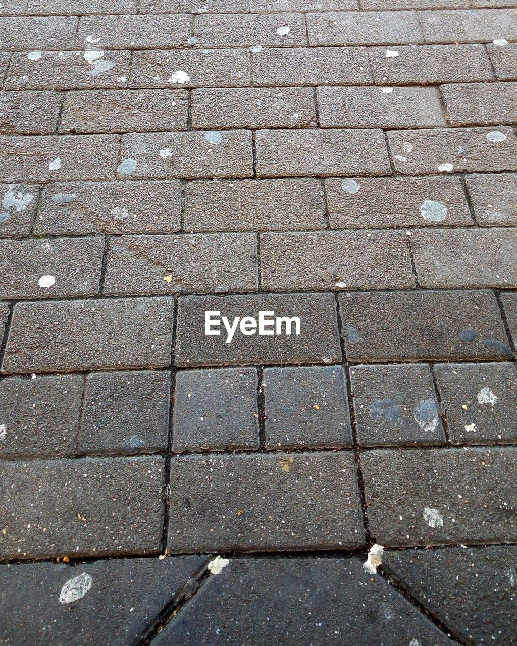 footpath, pattern, backgrounds, full frame, high angle view, stone, street, no people, city, paving stone, day, cobblestone, textured, outdoors, stone material, road, nature, solid, transportation, sidewalk