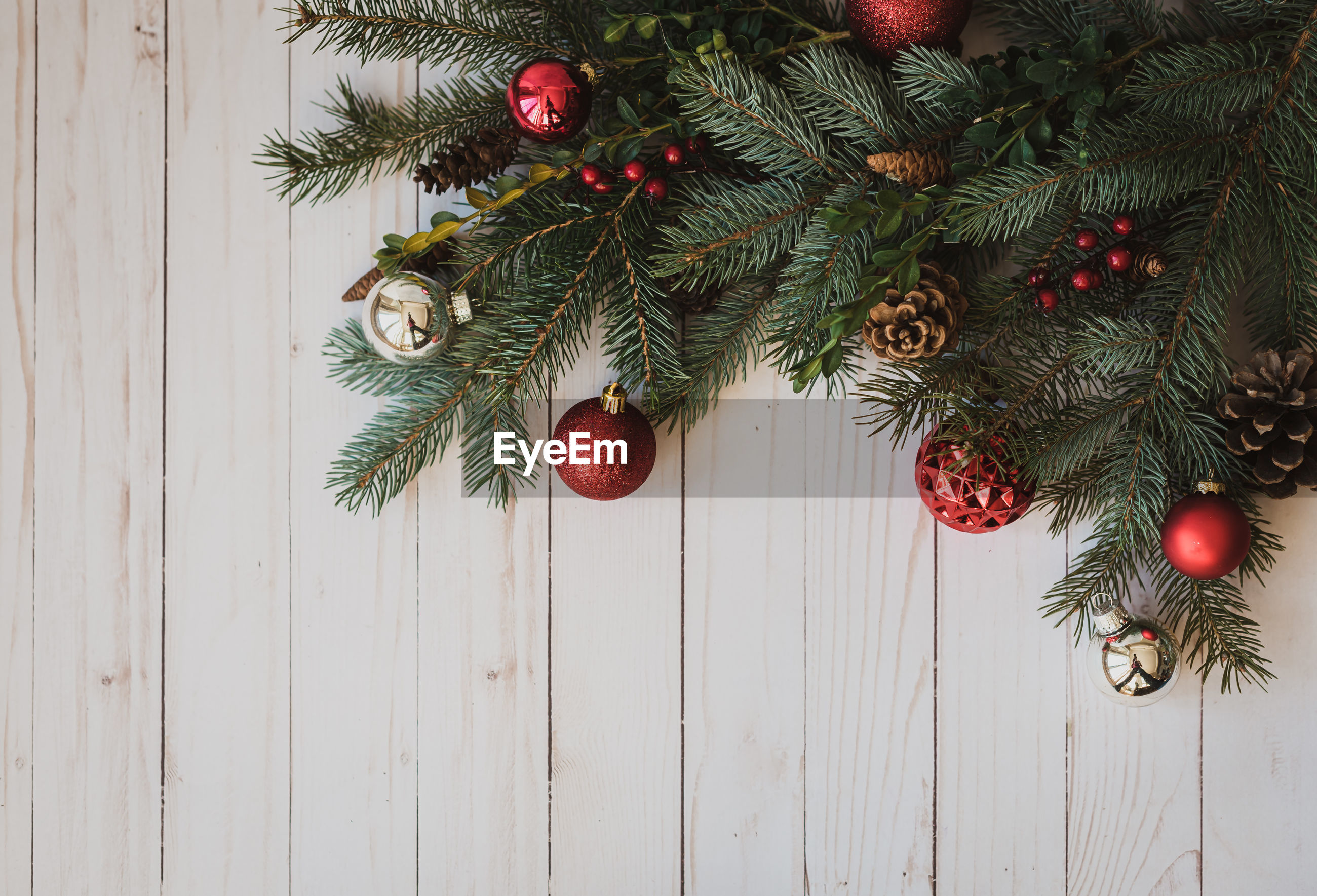 CLOSE-UP OF CHRISTMAS TREE HANGING ON BRANCH